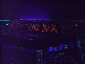tiki bar sign black light