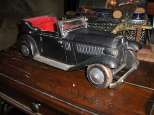1950's Rolls Royce Bar Car. This was a very expensive model. Unfortunately this one was used as a toy. Were it in better condition and complete, it would be worth hundreds $$$.