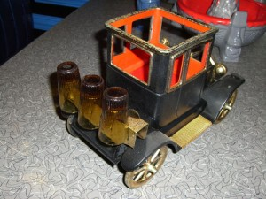 Bar Car Model T Ford showing three shot glasses on the trunk.