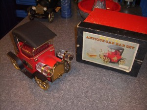 Bar Car Tin Lizzie Roadster with original box. The headlights are shot glasses, giving it a sort of Mr. Magoo look.
