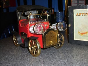 Bar Car Tin Lizzie with Mr. Magoo shot-glass headlights. The crank winds the music box.