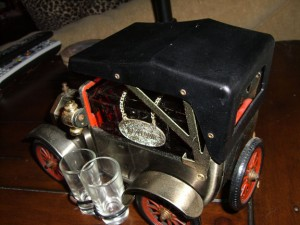 Bar Car 1918 Model T Ford Sedan with brushed bronze finish, spoked wheels &amp; rubber tires.