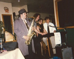 "Playing Sax in ""Who Shot The Piano Player?!"", a StarDust Productions murder mystery dinner show"