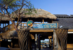 Holiday Isle Tiki Bar in Islamorada, FL is a typical Keys-style Tiki Bar. You won't find any carved Tikis here, but they do claim to have invented the Rum Runner.