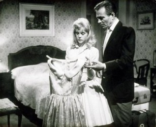 Lolita and Humbert in a very suggestive scene.