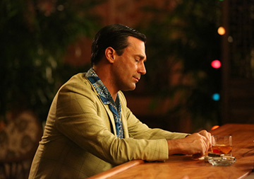 Don Draper pondering his favorite booze